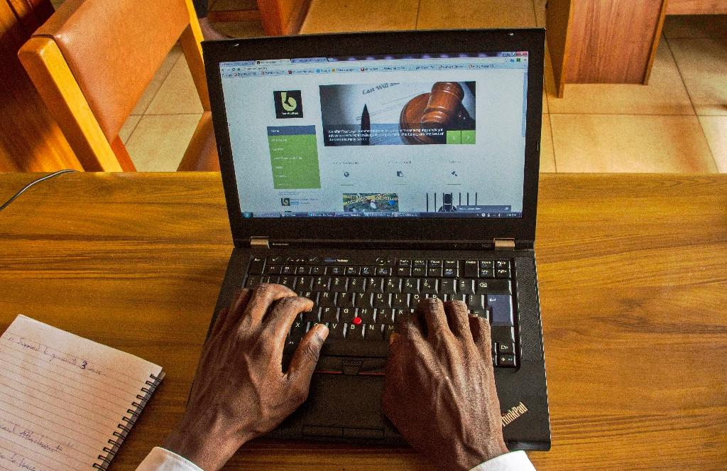 Barefoot Law was born two years ago when Gerald Abila began offering legal advice via social media and Skype (AFP Photo/Isaac Kasamani)