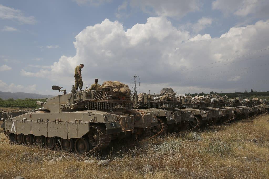 Israeli Merkava Mark IV tanks take position near the Syrian border in the Israeli-annexed Golan Heights on May 9, 2018 amid rising tensions on the frontier (AFP Photo/JALAA MAREY, JALAA MAREY)