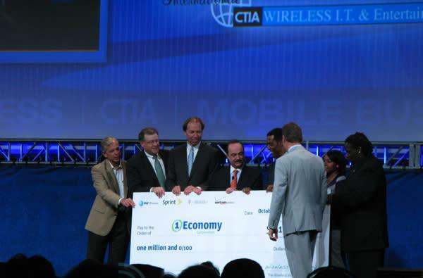 Caption contest: Big Four's CEOs finally united by a very large check