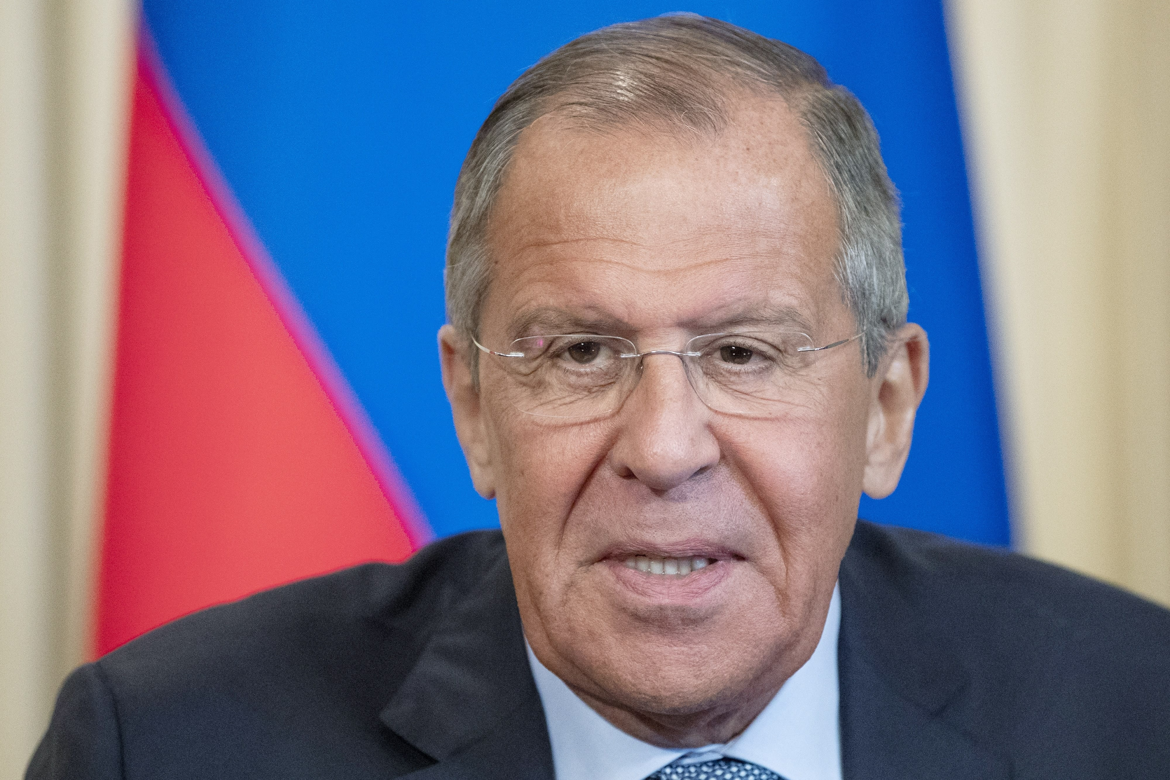 Russian Foreign Minister Sergey Lavrov smiles during his meeting with Turkish Foreign Minister Mevlut Cavusoglu in Moscow, Russia, Friday, Aug. 24, 2018. Turkey's Foreign Minister on Friday warned against a possible Syrian government offensive on the last remaining opposition stronghold while Russia indicated that it's losing its patience with the rebels. (AP Photo/Pavel Golovkin)