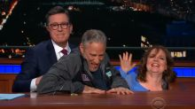 Jon Stewart hangs out under Stephen Colbert's desk with charity contest winner