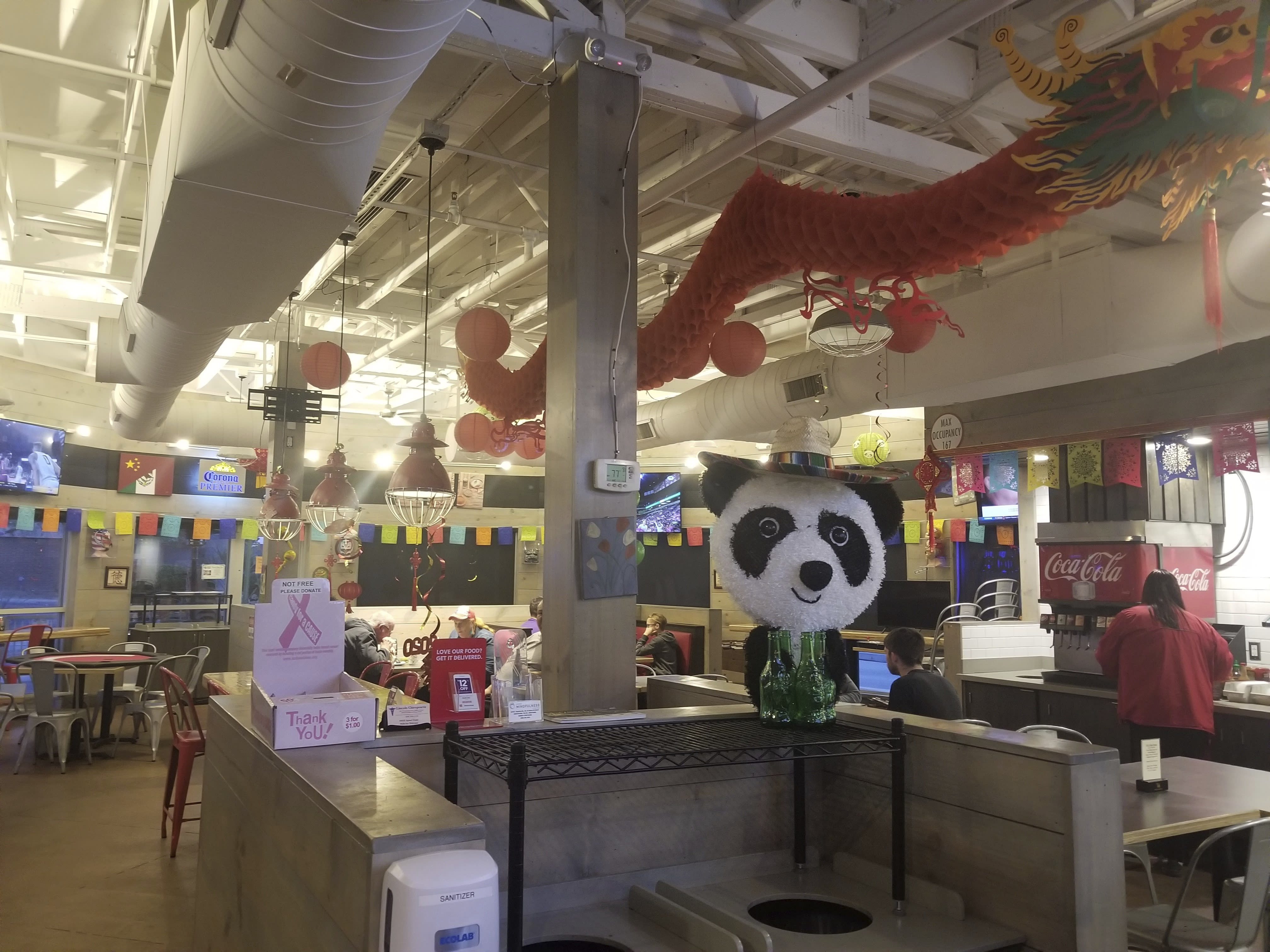 """This Feb. 27, 2020 photo shows the inside of Panda Libre, an Asian-Mexican fusion restaurant, in Gilbert, Ariz. Getting a trademark for the new name can lead to ugly and sometimes public clashes over ownership and cultural appropriation. In recent years, businesses have butted heads over whether a restaurant or food truck can legally own the right to use words rooted in Asian American Pacific Islander cultures like """"aloha"""" and """"poke."""" (AP Photo/Terry Tang)"""