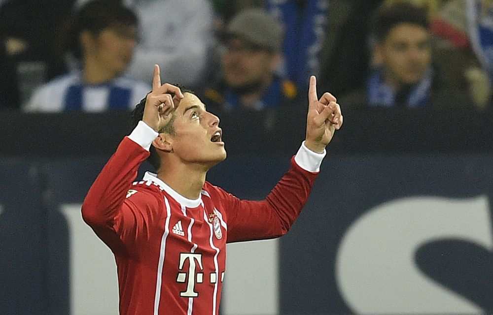 Bayern's James Rodriguez celebrates after scoring during the German Bundesliga soccer match between FC Schalke 04 and Bayern Munich at the Arena in Gelsenkirchen, Germany, Tuesday, Sept. 19, 2017. (AP Photo/Martin Meissner)