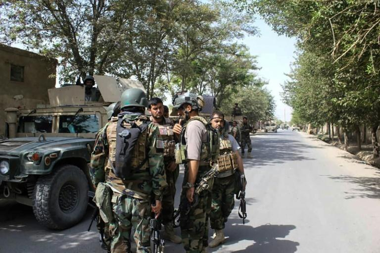 Afghan soldiers gather at a street in Kunduz, where US air power helped them beat back a brazen Taliban assault, but with the loss of 20 troops and five civilians, officials said (AFP Photo/Bashir KHAN SAFI)