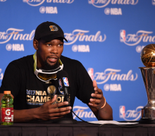 Kevin Durant sparred with a former ESPN reporter who's become a vocal conservative over his decision to not visit the White House