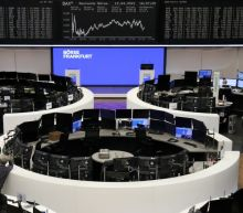 Global share markets rise after U.S. inflation remains contained