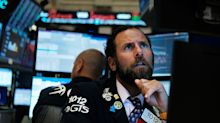 Futures whipsaw in another volatile day