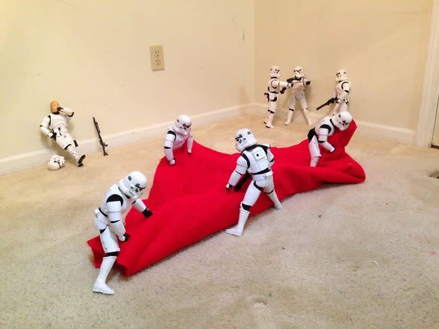 "<p>Shearrer <a href=""https://www.reddit.com/r/StarWars/comments/3uuvvx/stormtroopers_assembling_the_christmas_tree_by/"" rel=""nofollow noopener"" target=""_blank"" data-ylk=""slk:posted on Reddit"" class=""link rapid-noclick-resp"">posted on Reddit</a>, ""My dad owns about 10 Stormtroopers and we always like playing with them, [so we] figured we would do something a little more festive this year. The whole thing took probably an hour or two on and off to set up, and we had a blast trying to give every trooper a little story.""<br></p>"