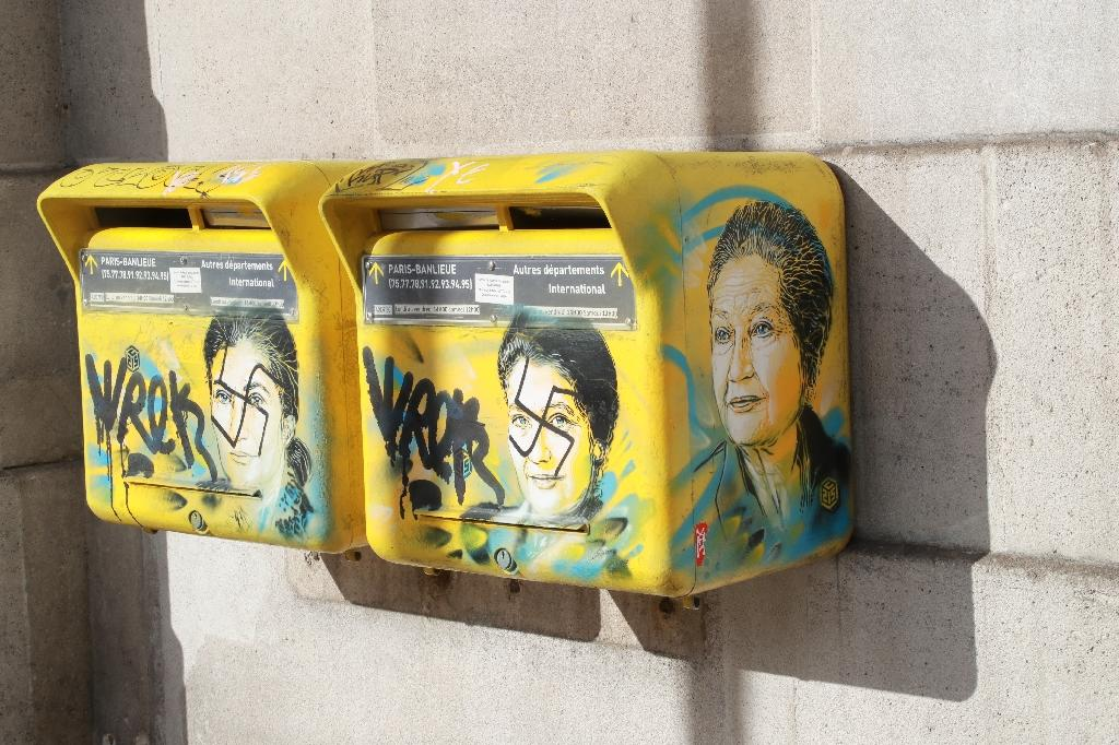 """""""French society is in trouble,"""" the son of the late Simone Veil said as he looked at the swastikas daubed on two post boxes decorated with pictures of his mother, a Holocaust survivor (AFP Photo/JACQUES DEMARTHON)"""