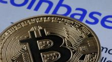 Coinbase shares close 14% below opening price after trading debut