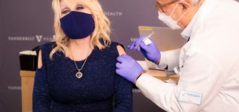 Dolly gets 'dose of her own medicine' with COVID shot