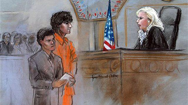 Boston bombings suspect faces victims for the first time