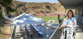 Dana Mikels, principal of Village Christian Middle School in Sun Valley, is photographed near an outdoor classroom, consisting of 18 tables, allowing one student per table. (Getty Images)