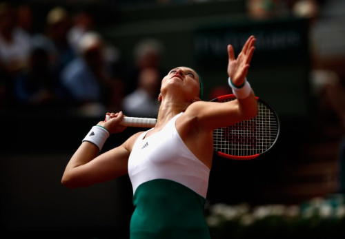 Kristina Mladenovic serves a ball to Shelby Rogers in the third round of the French Open (Getty Images)