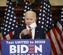 Biden says 'very top' of government should call for mask wearing, in jab at Trump