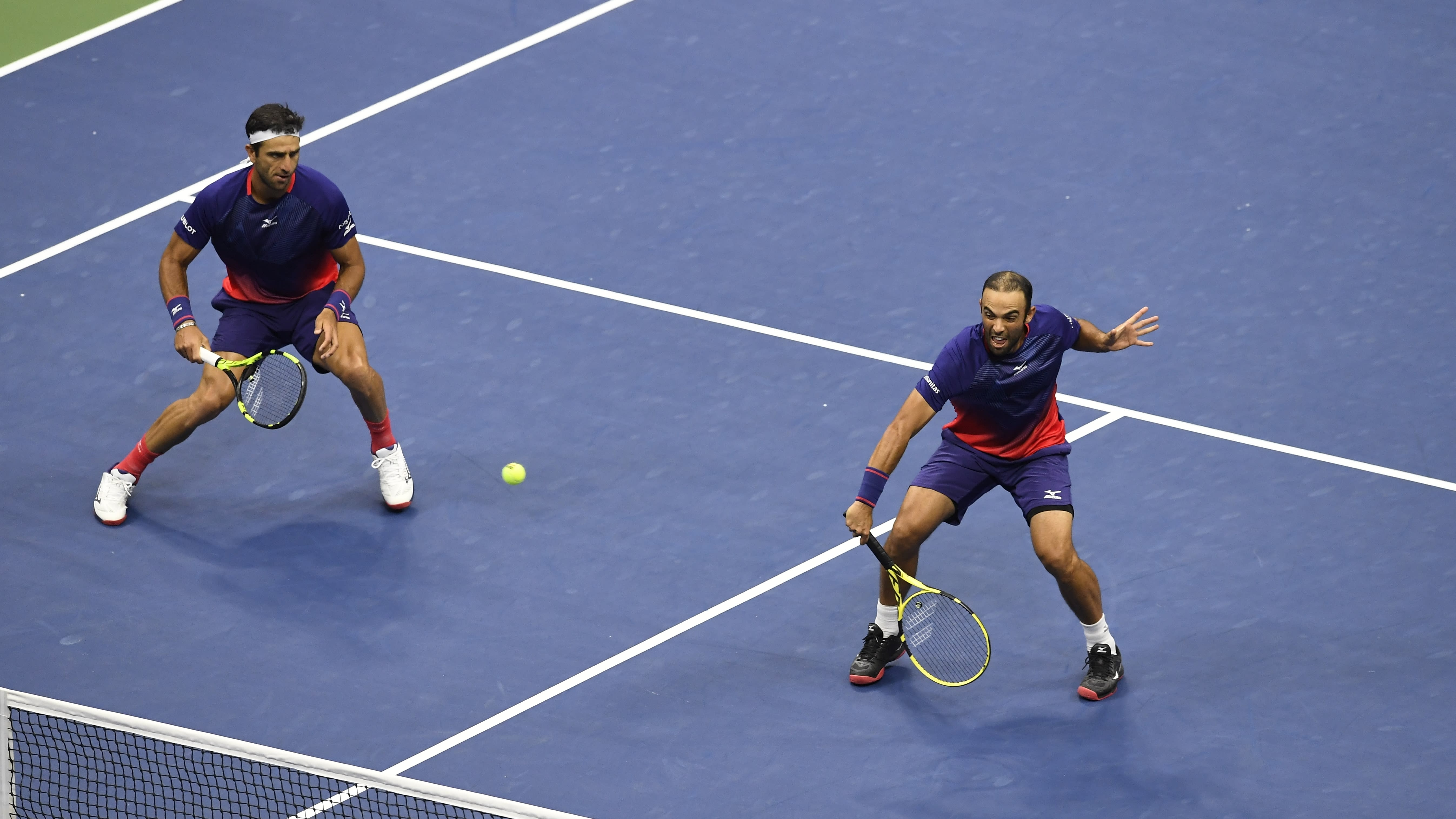 Robert Farah, and Juan Sebastian Cabal, both of Colombia, return a shot to Marcel Granollers, of Spain, and Horacio Zeballos during the final match of the U.S. Open tennis championships Friday, Sept. 6, 2019, in New York. (AP Photo/Sarah Stier)