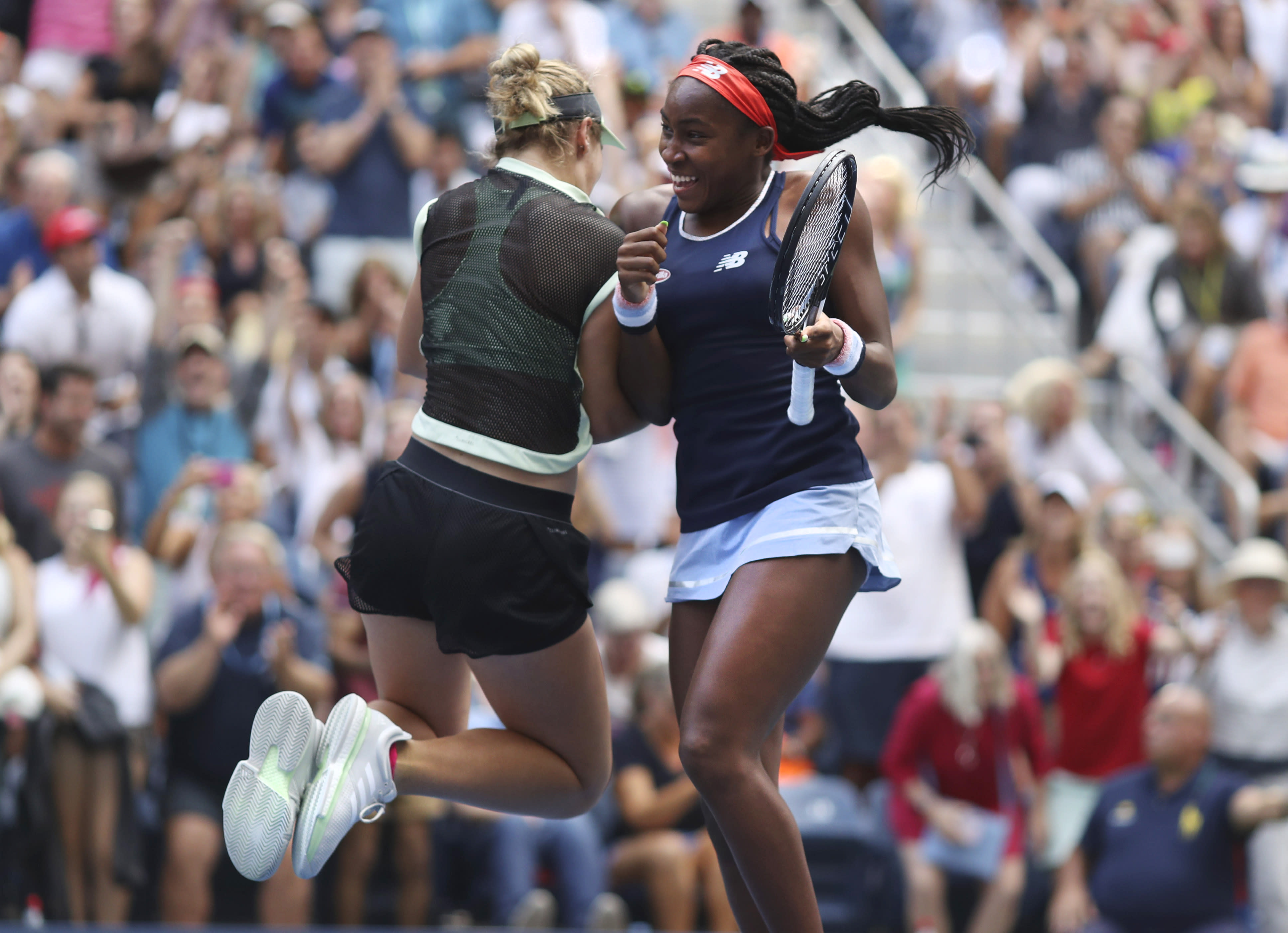 Coco Gauff, right, and her partner Catherine McNally celebrate after winning their women's doubles second round match, against Nicole Melichar and Kveta Peschjka, at the US Open tennis championships Sunday, Sept. 1, 2019, in New York. (AP Photo/Kevin Hagen)
