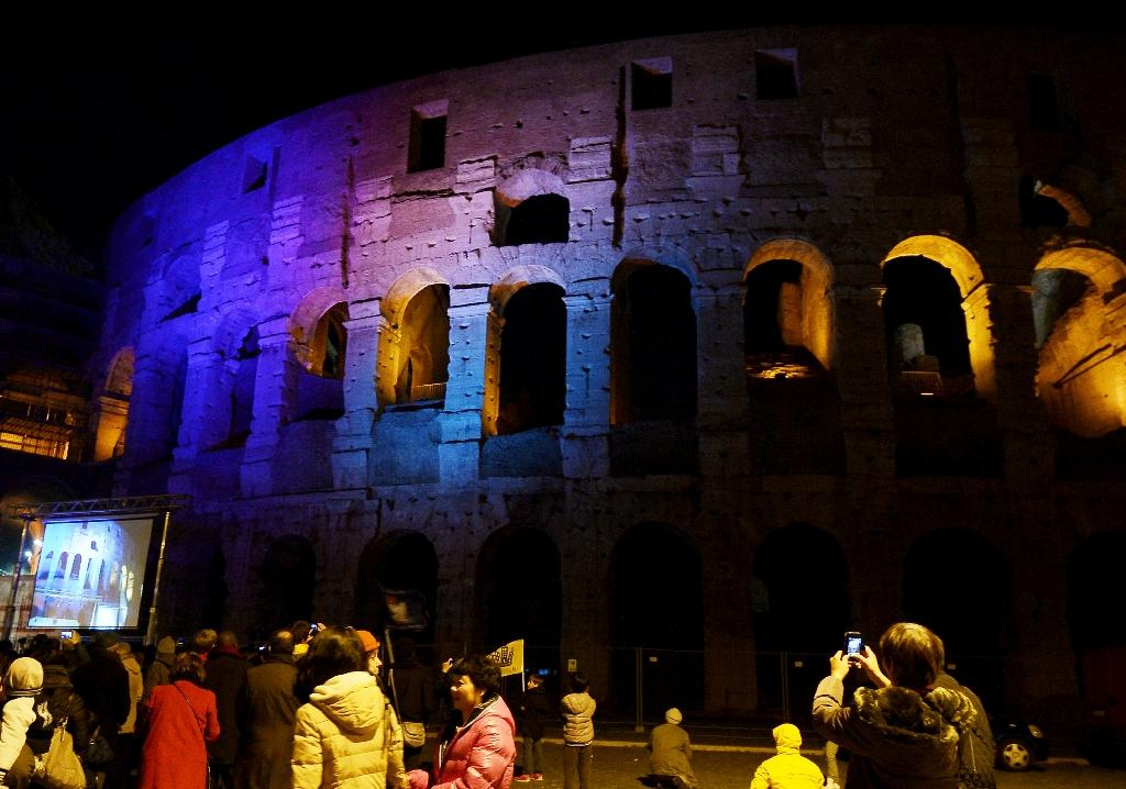 The ancient Colosseum is illuminated during the International Day of Cities for Life, Cities against the Death Penalty, in Rome, on November 30, 2015 (AFP Photo/Tiziana Fabi)