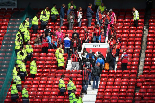 Bournemouth fans being asked to evacuate Old Trafford