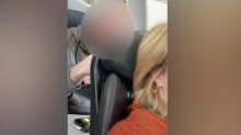 Video of man punching the back of airplane passenger's seat sparks debate: 'The seats are made to recline'