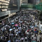 Hong Kong stocks sink as violent unrest hits city