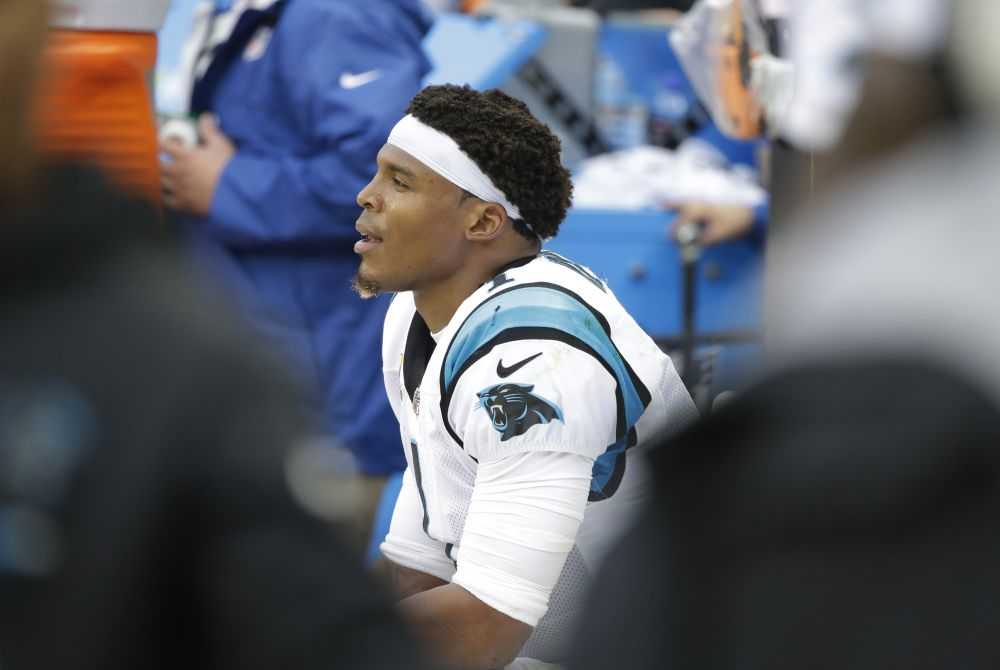 Cam Newton made quite an appearance and disappearance at Wednesday's media session with reporters. (AP)