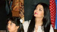 Aishwarya Rai Bachchan is a doting mother at Durga Puja