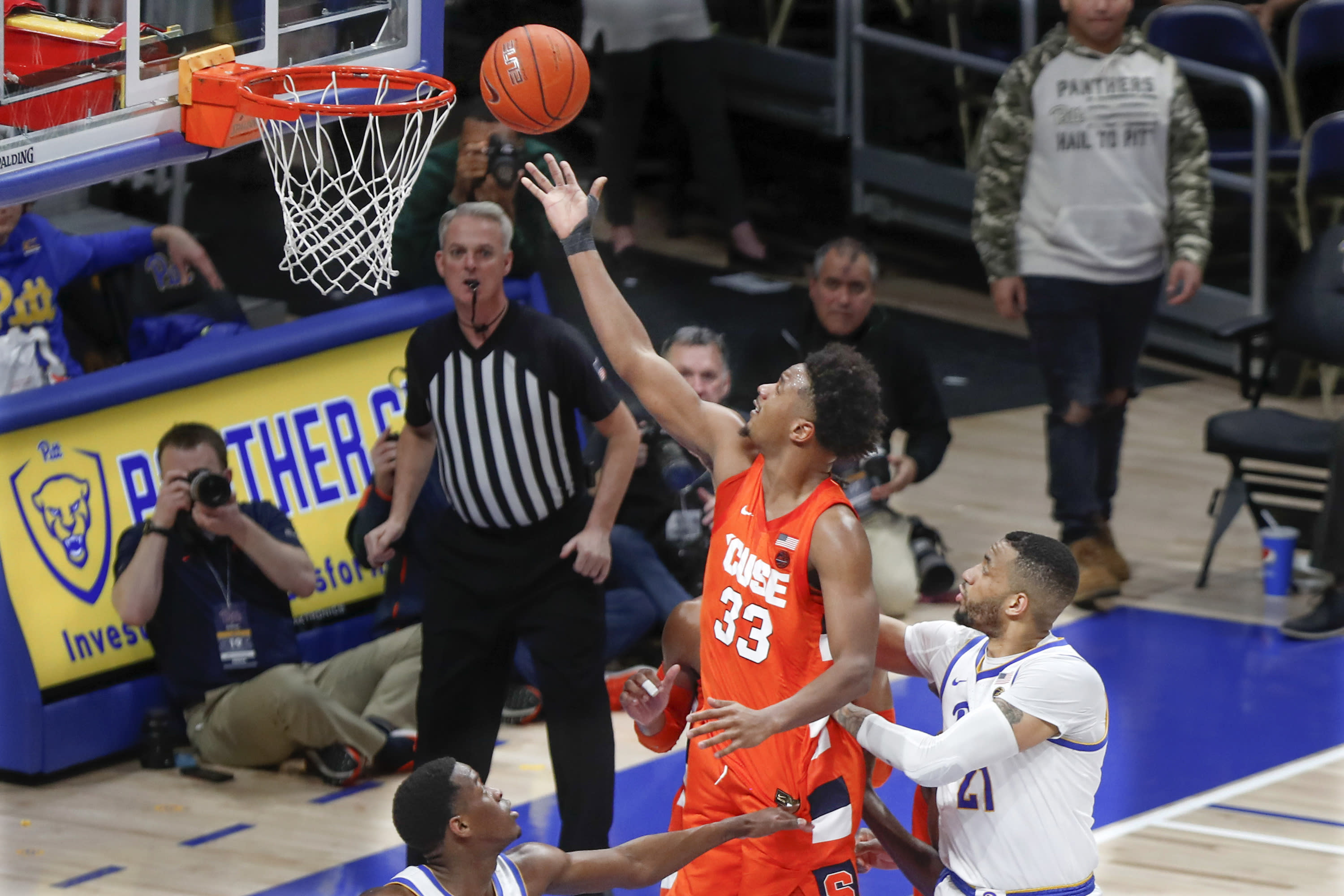 Syracuse's Elijah Hughes (33) scores after getting by Pittsburgh's Terrell Brown (21) during the second half of an NCAA college basketball game, Wednesday, Feb. 26, 2020, in Pittsburgh. (AP Photo/Keith Srakocic)