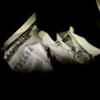 Dollar skids to fresh 2-1/2-year low as U.S. stimulus in focus