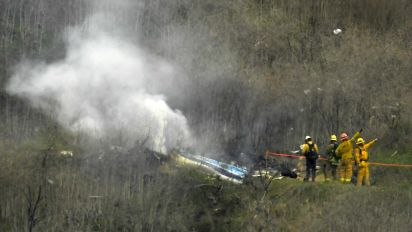 Investigators seek cause of Bryant helicopter crash