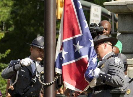 The Confederate battle flag is permanently removed from the South Carolina statehouse grounds during a ceremony in Columbia