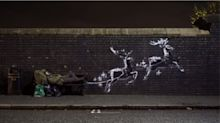 New Banksy mural features homeless man on bench