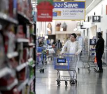 Walmart sees sales rise at stores and online, raises outlook