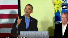 Barack Obama urges voters to reject 'politics of division'
