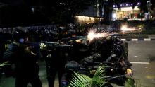 Indonesian police arrest at least 20 amid post-election violence