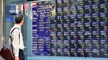 Asian stocks wobble after Fed hints at December rate hike