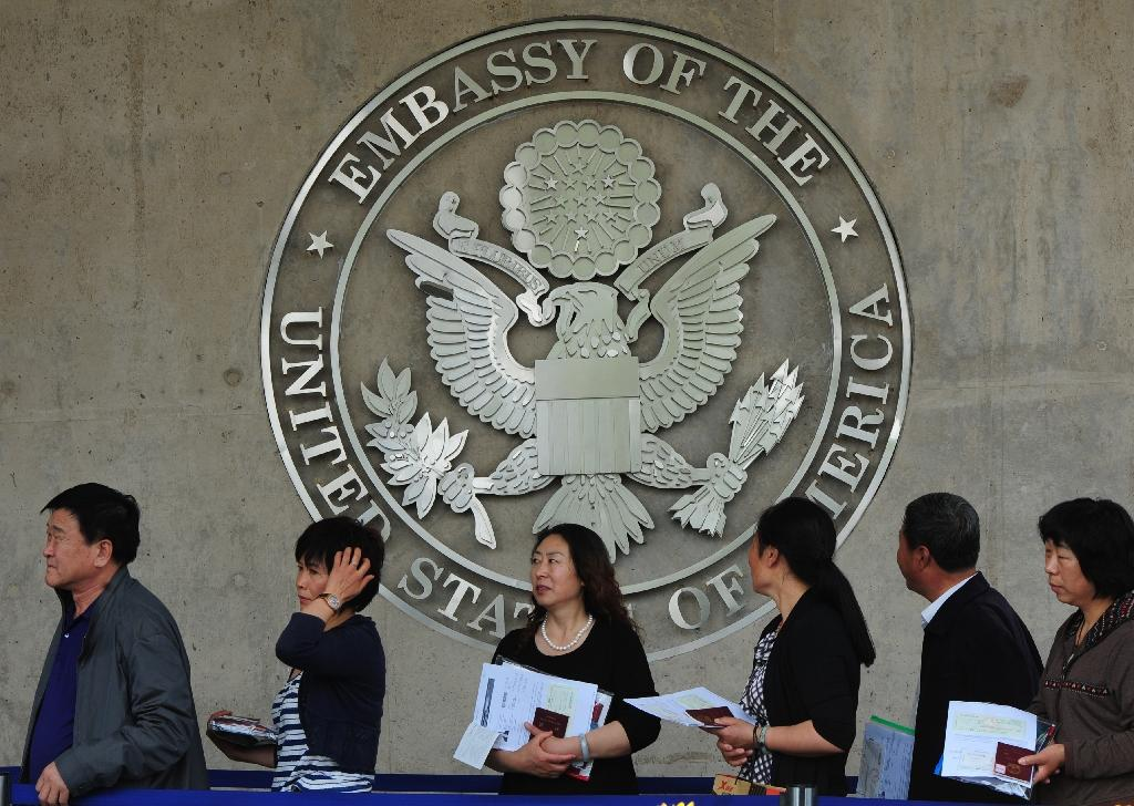 US visa applicants, such as these Chinese citizens seen in 2012, will be required to identify which social media platforms they use under new planned measures