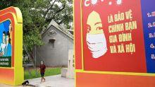 Hanoi goes into lockdown as virus cases soar