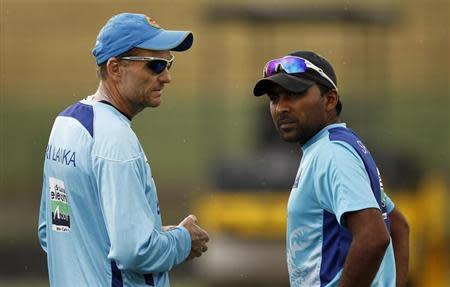 Sri Lanka's captain Mahela Jayawardene talks with coach Graham Ford during a practice session ahead of their Twenty20 cricket match against India, in Pallekele