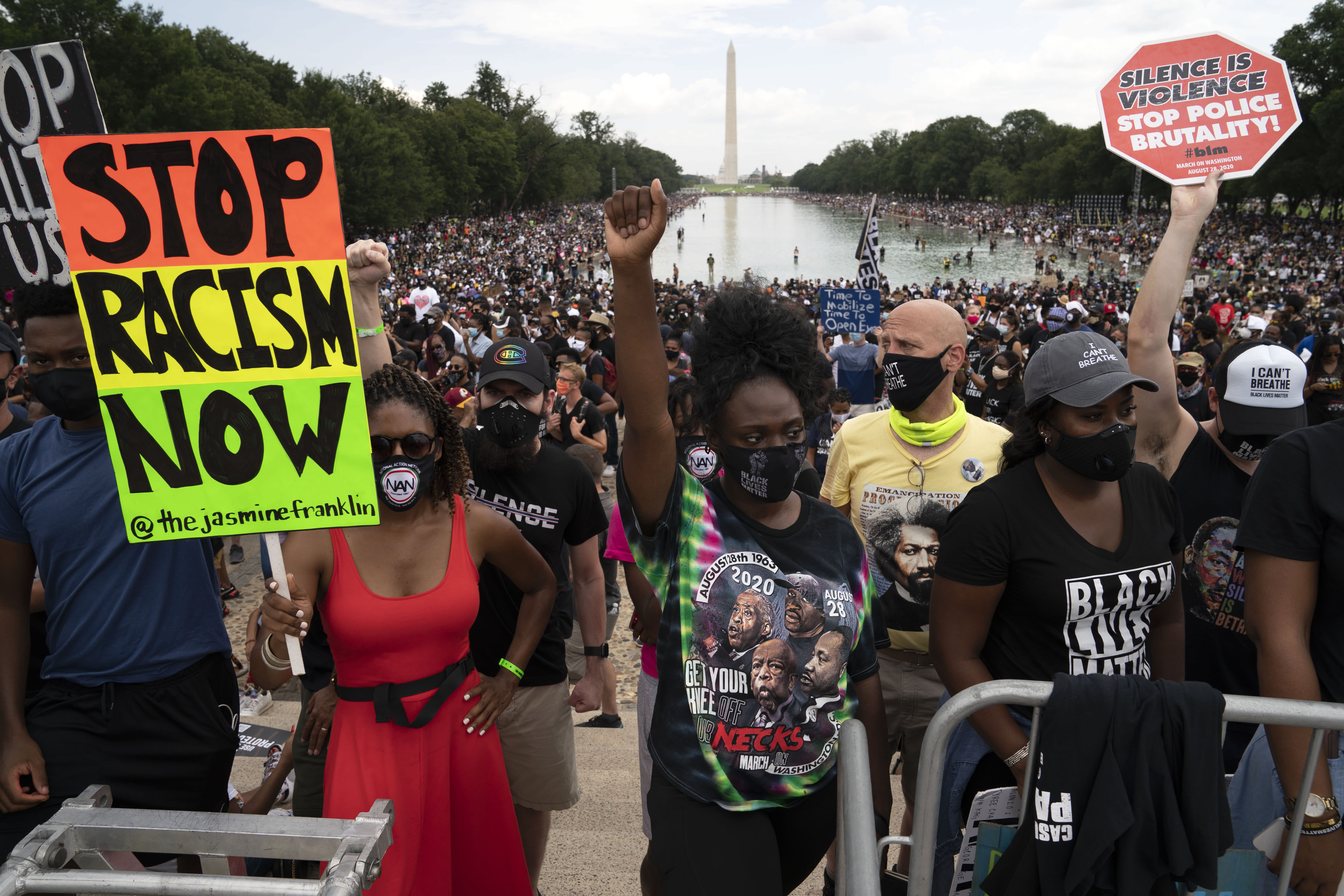 """Demonstrators rally at Lincoln Memorial during the March on Washington, Friday Aug. 28, 2020, on the 57th anniversary of the Rev. Martin Luther King Jr.'s """"I Have A Dream"""" speech. (AP Photo/Jose Luis Magana)"""