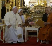 The Latest: Pope again denounces ills of human trafficking
