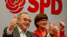 Germany's SPD shifts left but gives Merkel coalition 'a chance'