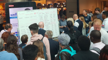 Chaos at Gatwick Airport as information screens fail and staff forced to write flight details on WHITEBOARDS