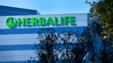Herbalife cuts sales forecast, but boosts earnings guidance and exceeds key FTC mandate