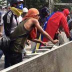 Demonstrators Clash with Police in Caracas Streets as Juan Guaido Declares Himself Interim President of Venezuela