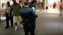 Black teen arrested for violating mall's 'no hoodie' dress code; man who defended him also detained