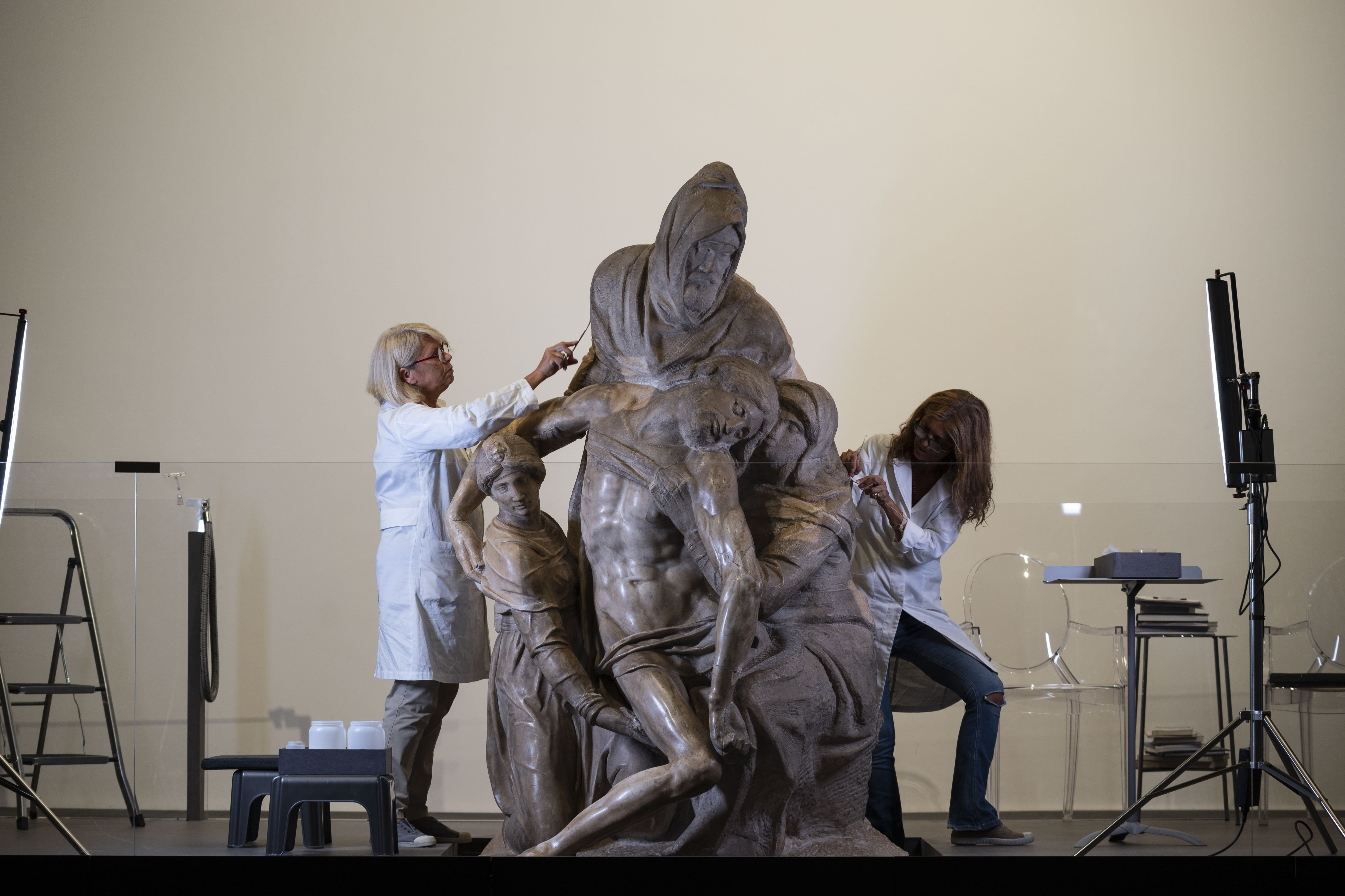 Restorers work on one of Michelangelo's Pieta sculpture in Florence, Italy, Tuesday, Sept. 8, 2020. A restoration of one of Michelangelo's Pieta sculptures has uncovered previously unknown details, including the artist's tool marks, that had been hidden under centuries of dust and wax. Florence's Museo dell'Opera del Duomo said Wednesday, Sept. 16, 2020 that the cleaning of the Bandini Pieta, which began last year but was suspended because of the coronavirus pandemic, had resumed and that the public was now invited to watch restorers at work. Michelangelo carved the Bandini Pieta between 1547-1555, when he was nearly 80. (Claudio Giovannini/Opera di Santa Maria del Fiore via AP)