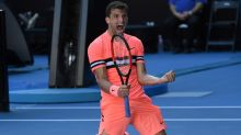 Dimitrov back on track at searing Australian Open