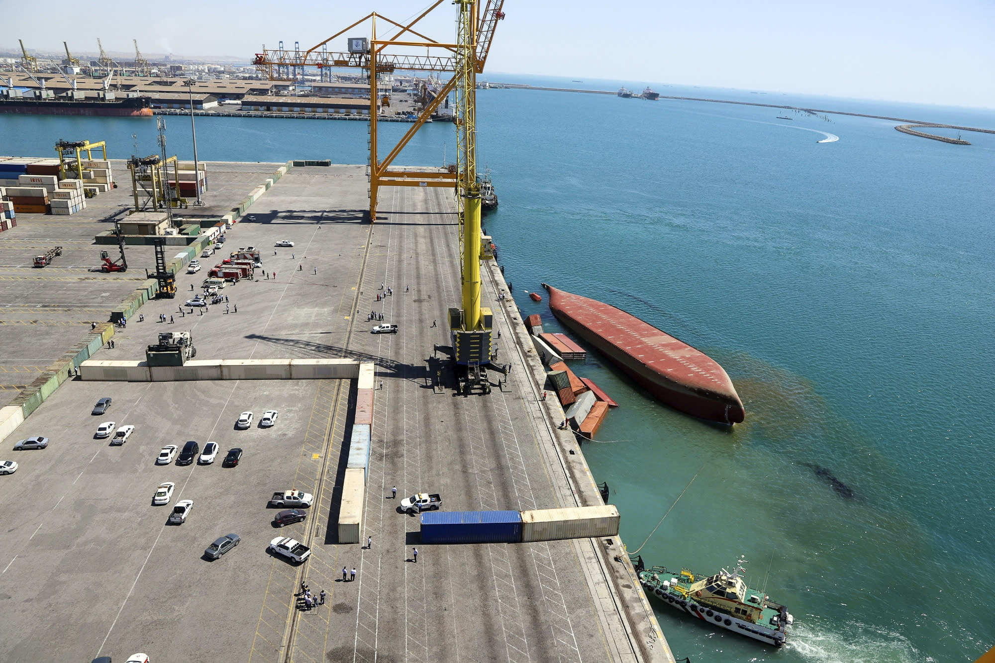 Careless loading of cargo containers sinks ship in Iran port