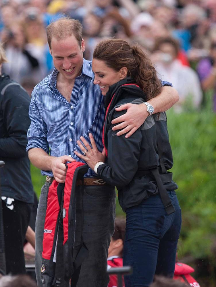 The newyweds are cute and casual, in a rare embrace(public, at least!) after taking part in a dragon boat race.